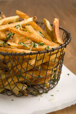 Fresh home cut french fries with fresh parsley and parmesan cheese