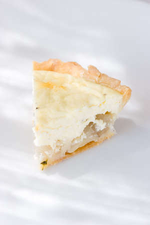 A slice of Goat cheese and onion tart with flour crust Stock Photo - 1172990