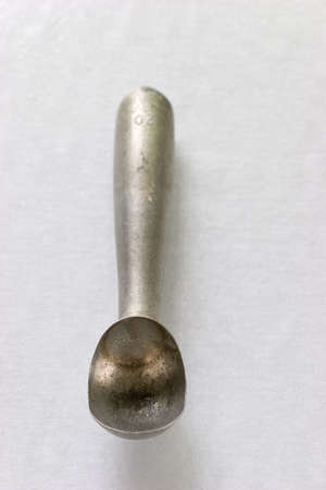 old fashioned metal ice cream scoop looking for a good pint to scoop