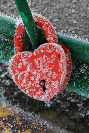 a frozen metal lock in the shape of a heart Stock Photo