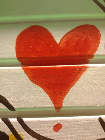 Red heart motif drawn on the wall. Decorative background of heart. Design elements for Valentine`s Day