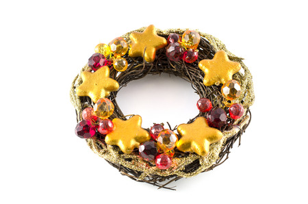 Christmas wreath decorated with various ornaments on a white background