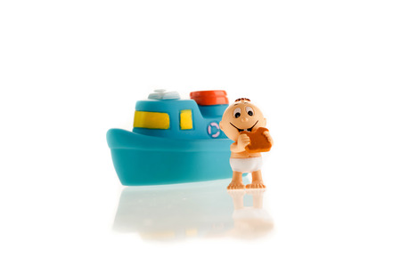 Colored toys the little boy and the blue ship Stock Photo