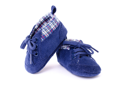 a pair of children's sports shoes made of cloth