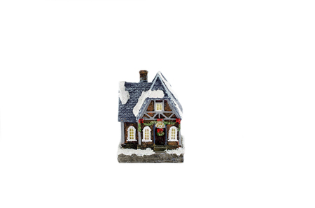 Christmas decorated house with snow on roof