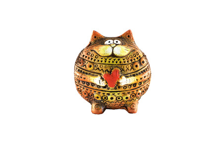 clay cat stands with heart in hands