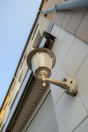 Retro lantern hanging on the house