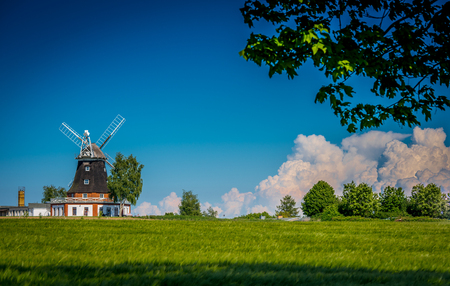 Windmill and blue sky background.