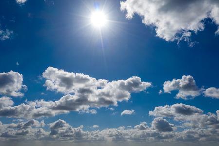 a dreamlike blue sky with white sheep clouds