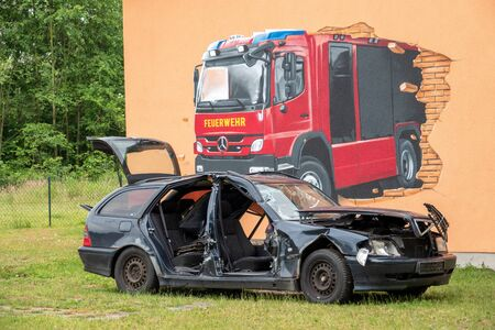 on the premises of the fire brigade there is a wrecked car that is used for training purposes