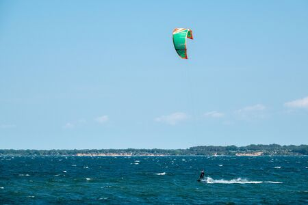 Kite surfers race across the sea