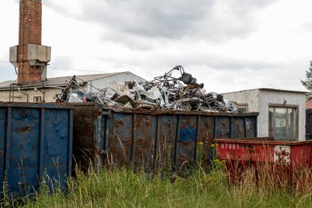 Metal scrap is located in large containers