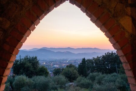 a colourful sunset in Tuscany in Italy Banco de Imagens