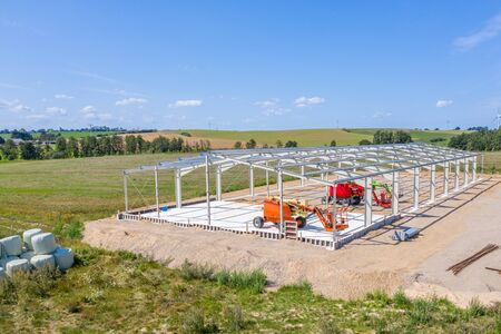 The basic structure of a new hall is erected in an industrial estate