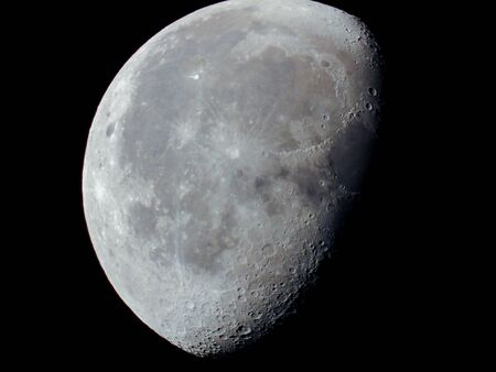 a very dense close-up of a decreasing moon in the night sky Stockfoto