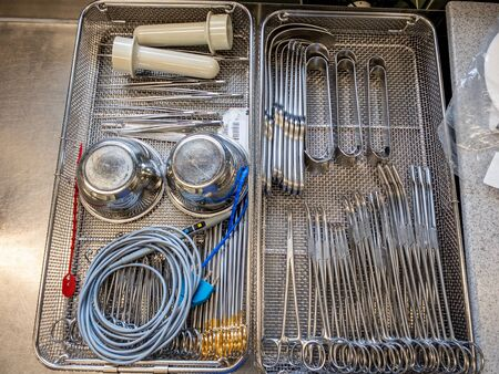 a single instrument tray contains various surgical instruments Stock Photo