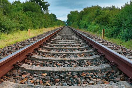a drone flies in good weather at a very low altitude over railway tracks