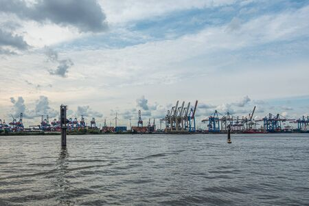 a panoramic view of the port of Hamburg in cloudy weather