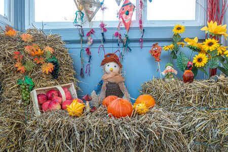 on a bale of straw apples and pumpkins were lovingly arranged as decoration