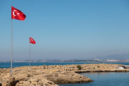 in the port of Side the Turkish flag blows at a mast