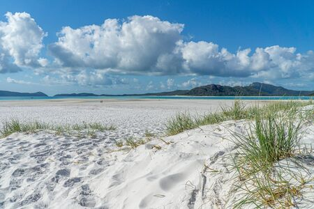 the white beach of the Whitsunday Islands in Australia, which consists of 99 percent quartz sand, and the azure blue sea
