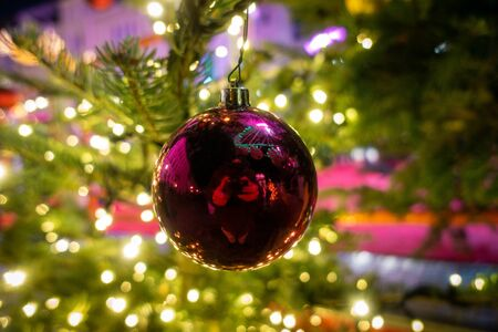 a shiny Christmas ball hanging from a Christmas tree as a decoration Reklamní fotografie