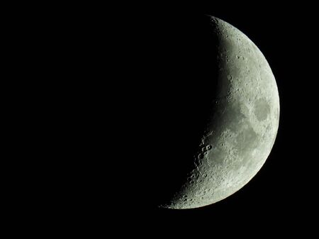 The term increasing crescent moon is used to describe the period after a new moon in which less than half of the illuminated half of the moon is visible from Earth. This transition moon phase ends with the increasing half moon, also called first quarter 版權商用圖片