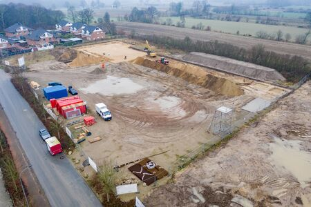 a drone image of a large construction site where the floor is being prepared for a factory building