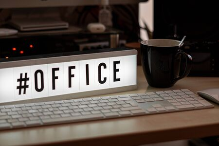 on a white illuminated cinema sign stands with black letters #office Stockfoto