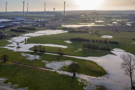a drone flight over meadows and fields, which were flooded after heavy rain
