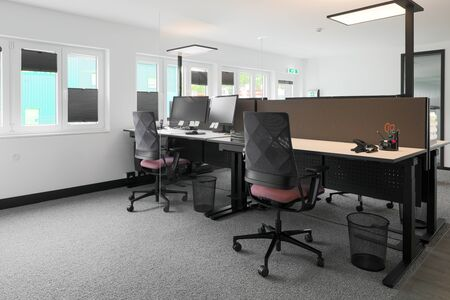 a modern equipped office workstation in an office building