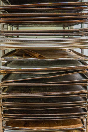 in a bakery there is a cart with baking trays Stockfoto