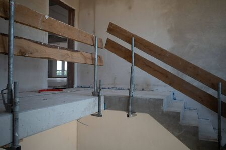 a temporary stair railing is built on a construction site