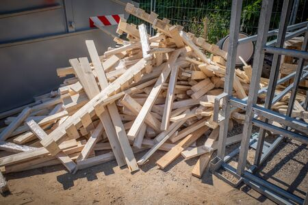 there's a pile of cut wood at a construction site