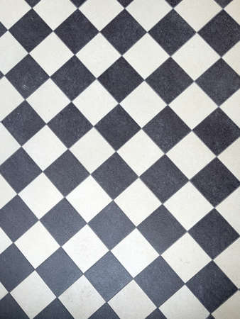 the black and white chess pattern of a floor
