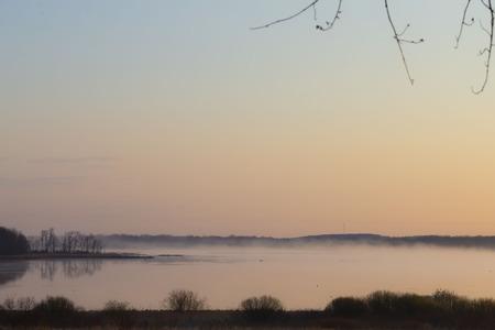 lake, river and landscape under spring mist