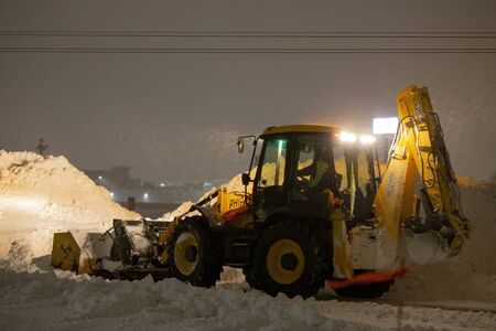 Manitowoc, WI USA January 18 2020 : night snow removal from the parking lot