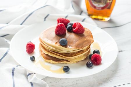 maslenitsa: Breakfast. Berries. Pancakes. Romantic breakfast on a wooden table. Spring morning. Cozy. Stock Photo