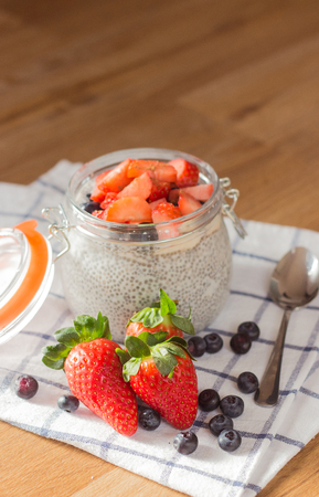 hype: Chia seeds. A delicious healthy breakfast. Diet. Berries and pudding. Stock Photo