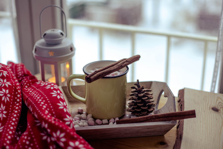 Mug of hot cocoa with marshmallow. Breakfast by the window. Christmas mood. Holidays. A cozy evening. Winter evening. Autumn.