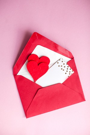Valentines day concept. Valentine, hearts, card on a pink background. Holidays.