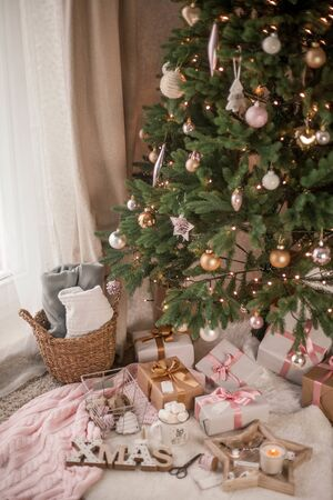 Christmas decor. Christmas mood. Christmas tree, gifts, wrapping, ribbons, candle. Cozy. Holidays.