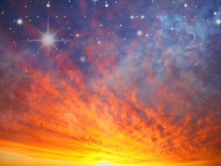 Beautiful fiery sunset, the evening sky and stars in the fire photo