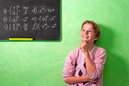 Young attractive boy standing in front of blackboard with wondering face expression. Stock Photo - 11914539