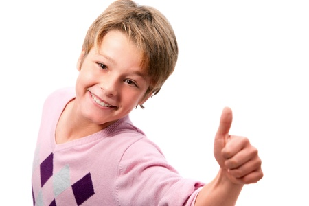 Portrait of young handsome boy showing thumbs up isolated on white background Stock Photo - 11914536