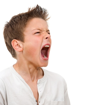Close up portrait of angry boy shouting  Isolated on white background Stock Photo