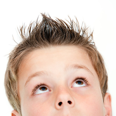 close up eyes: Extreme close up portrait of boy looking up Isolated on white