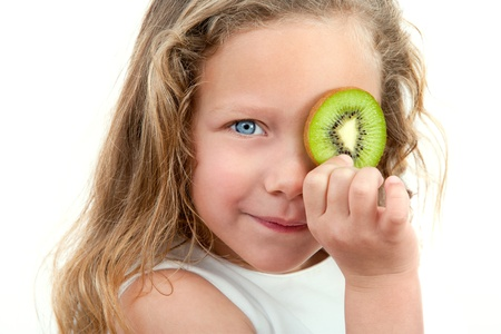 Close up Portrait of cute little girl holding fruit in front of eye  Isolated on white background Stock Photo - 12671696