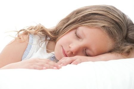 innocent girl: High key Close up of sweet little girl sleeping  Isolated on white background  Stock Photo