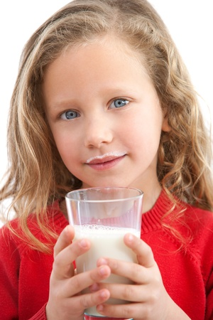 Close up Portrait of cute little girl holding glass of milk  Isolated on white background  Stock Photo - 12671710